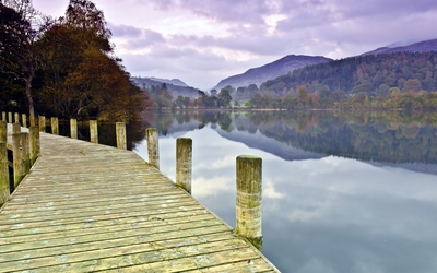 Wooden pier on the lake by the beautiful autumn forest wallpaper
