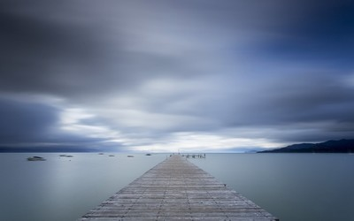 Wooden pier to the mystic ocean wallpaper