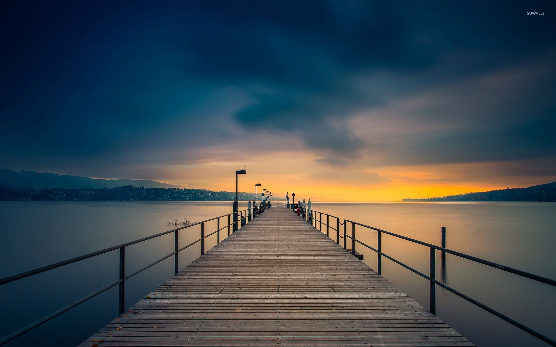 Wooden Pier Towards The Golden Sunset Wallpaper