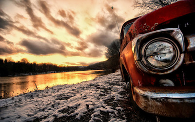Abandoned truck near the river wallpaper