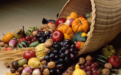 Autumn fruit pouring from cornucopia wallpaper