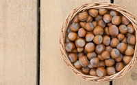 Basket of hazelnuts on wooden panels wallpaper 3840x2160 jpg