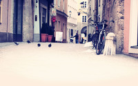 Bikes on the narrow city street wallpaper 2560x1440 jpg