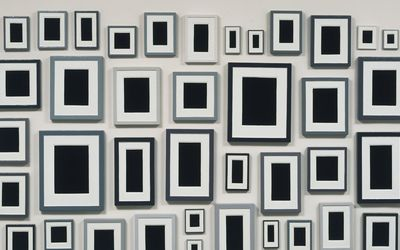 Black photos in frames wallpaper