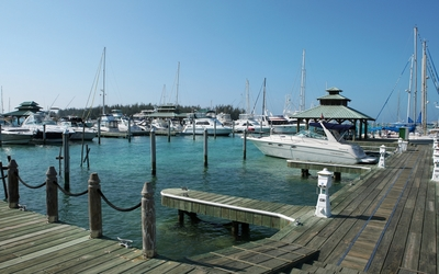 Boats in the harbor by the wooden pier Wallpaper