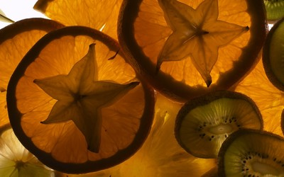 Carambola in orange slices wallpaper