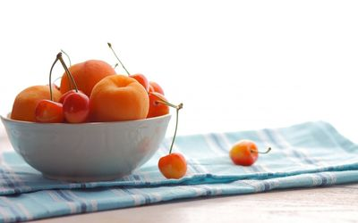 Cherries and apricots wallpaper