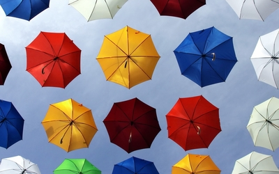 Colorful umbrellas floating wallpaper