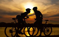 Couple on bikes at sunset wallpaper 1920x1080 jpg