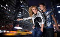 Couple waiting for a taxi in a big city wallpaper 2560x1600 jpg