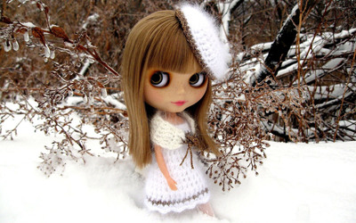 Doll dressed in white by a frozen tree wallpaper