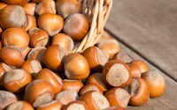 Hazelnuts spilled from a wicker basket wallpaper 3840x2160 jpg