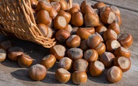 Hazelnuts spilled on an old table wallpaper 3840x2160 jpg