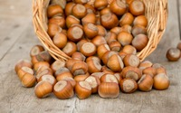 Hazelnuts spilling from a basket wallpaper 3840x2160 jpg
