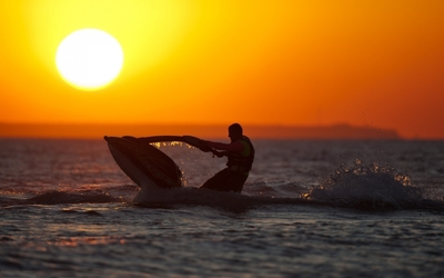 Jet Skiing at sunset wallpaper