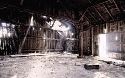 Light shines in the ruined barn Wallpaper