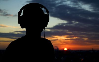 Listening to music at sunset wallpaper