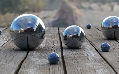 Metallic spheres reflecting the city wallpaper