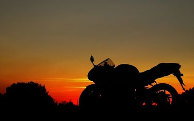 Motorcycle silhouette at sunset wallpaper
