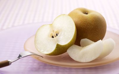 Nashi pear on a table Wallpaper