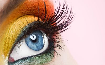Orange and yellow makeup on the blue eyes wallpaper