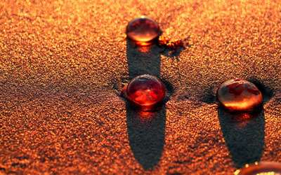 Paint drops on sand wallpaper