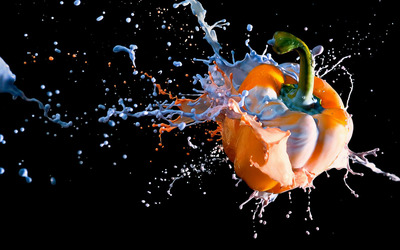 Paint splash on an orange pepper wallpaper