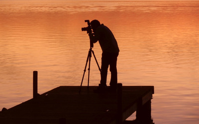 Photographer capturing the sunset wallpaper