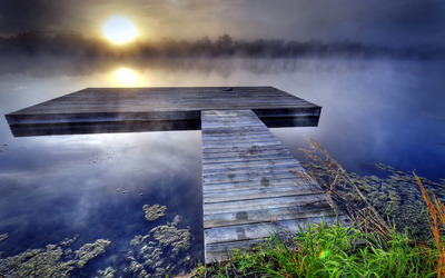 Pier on foggy lake wallpaper