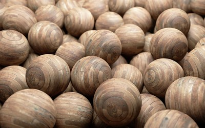 Pile of wooden orbs Wallpaper
