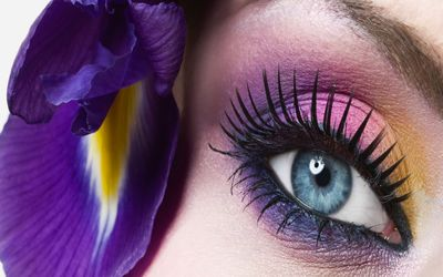 Pink and purple makeup on the blue eye wallpaper