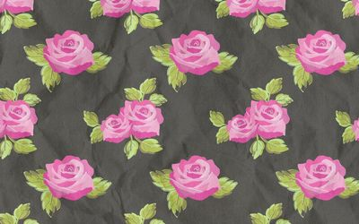 Pink rose pattern on a fabric wallpaper