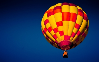 Red and yellow hot air balloon up in the air wallpaper