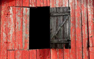 Red barn with a window opened wallpaper
