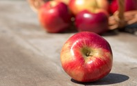 Red shiny apple on a wooden table wallpaper 3840x2160 jpg