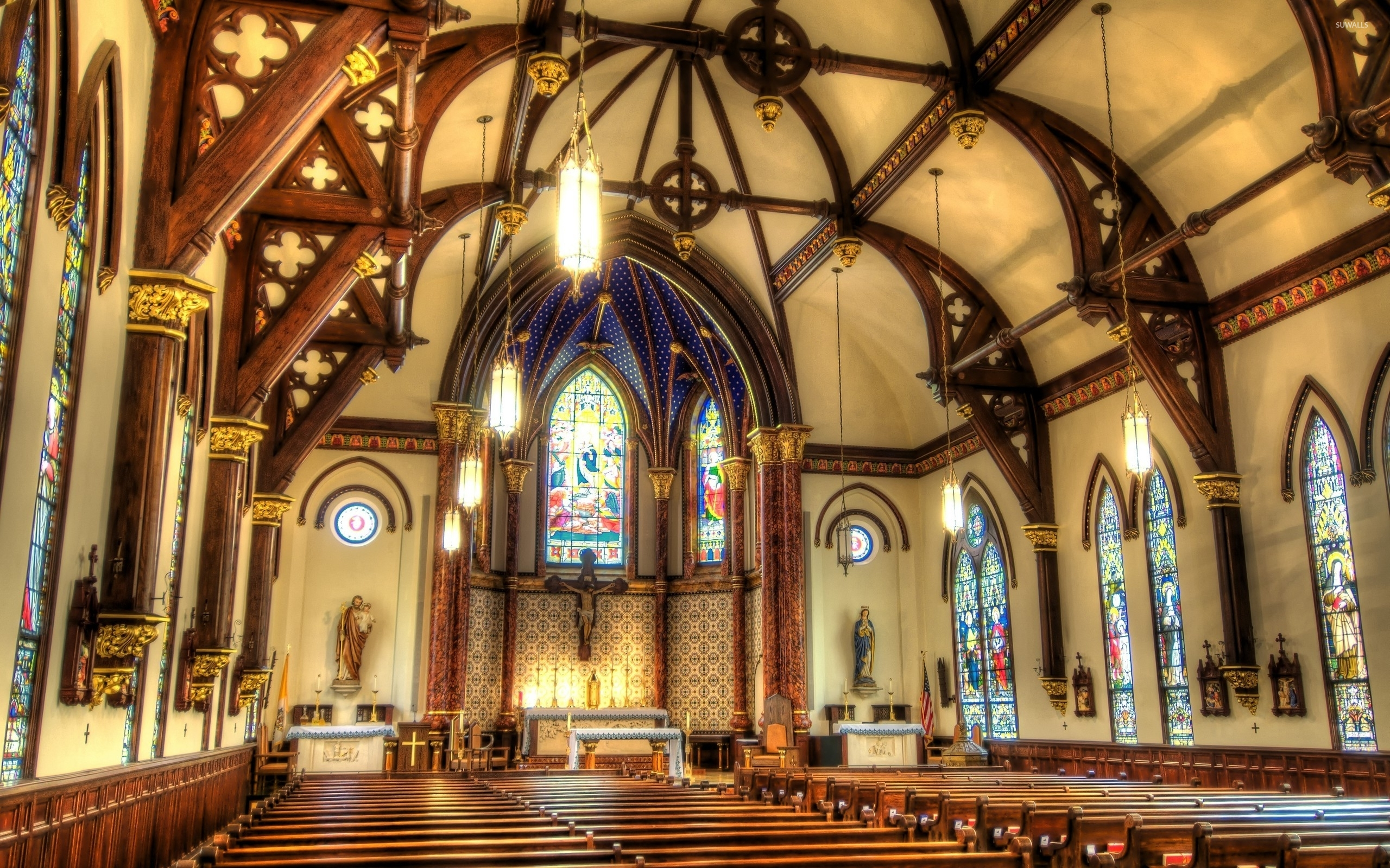 Religious Statues In A Catholic Church Wallpaper