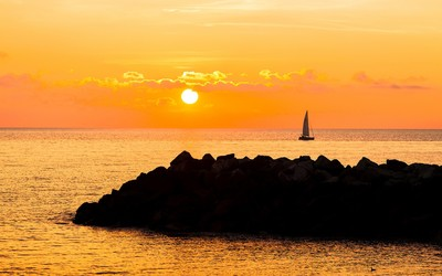 Sailboat in the sunset wallpaper