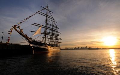 Sailing ship at sunset Wallpaper