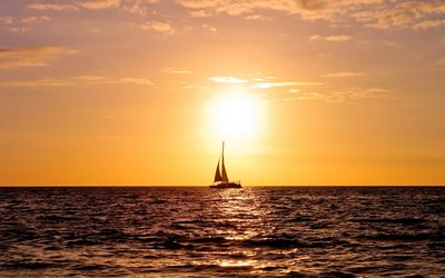 Sailing ship enjoying the ocean sunset Wallpaper