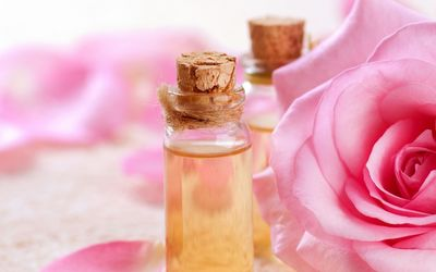 Scented oils and a pink rose wallpaper