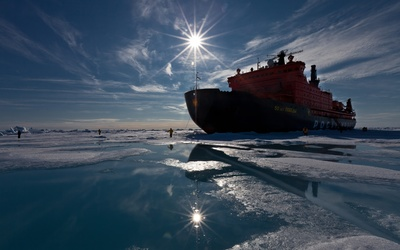Ship on icy water wallpaper