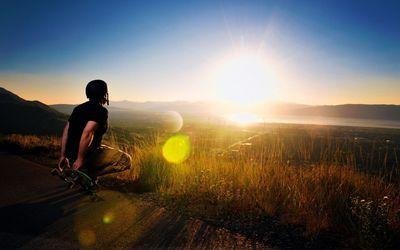 Skater watching the sunset wallpaper