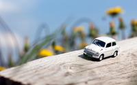 Small car on a log wallpaper 2560x1600 jpg
