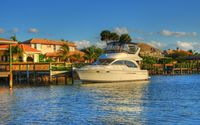 Small yacht harbored by the mansions wallpaper 1920x1200 jpg