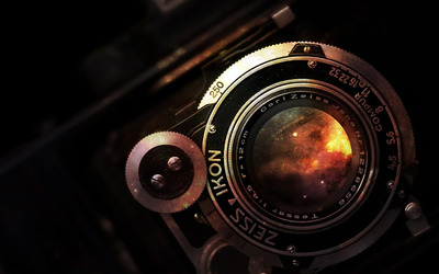 Space in vintage camera lens wallpaper