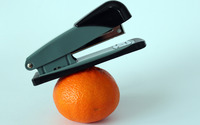 Stapler on an orange wallpaper 2880x1800 jpg
