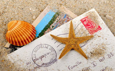 Starfish and shell on the letter wallpaper