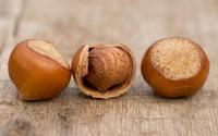 Three hazelnuts on wood wallpaper 2560x1600 jpg