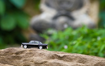 Toy car on a rock wallpaper