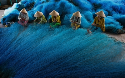 Vietnamese women with fishing nets wallpaper